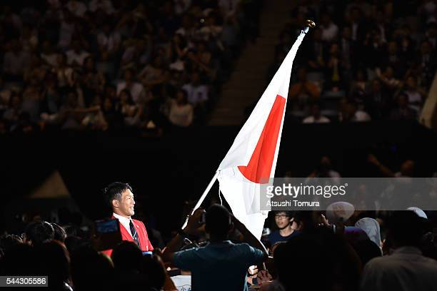 Flag-bearer Keisuke Ushiro of Japan attends the send-off event for the Japanese national team for Rio 2016 Olympics at Yoyogi National Gymnasium on...