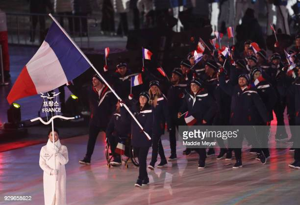 Flagbearer Marie Bochet leads the athletes of France as they walk in during the opening ceremony of the PyeongChang 2018 Paralympic Games at the...