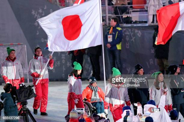 Flagbearer Momoka Muraoka of Japan enters the stadium during the closing ceremony of the PyeongChang 2018 Paralympic Games at the PyeongChang Olympic...