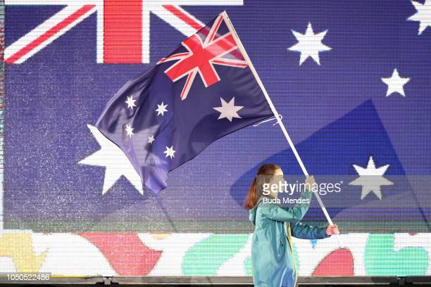 Flagbearer of Australia Keely Small walks the stage during the opening ceremony of the Buenos Aires 2018 Youth Olympic Games at Obelisco monument on...