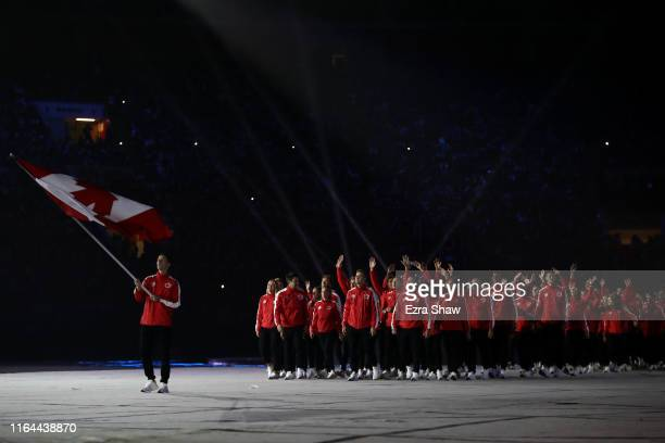 Flag-bearer of Canada Scott Tupper and the Team Canada during the opening ceremony of Lima 2019 Pan American Games at Estadio Nacional on July 26,...