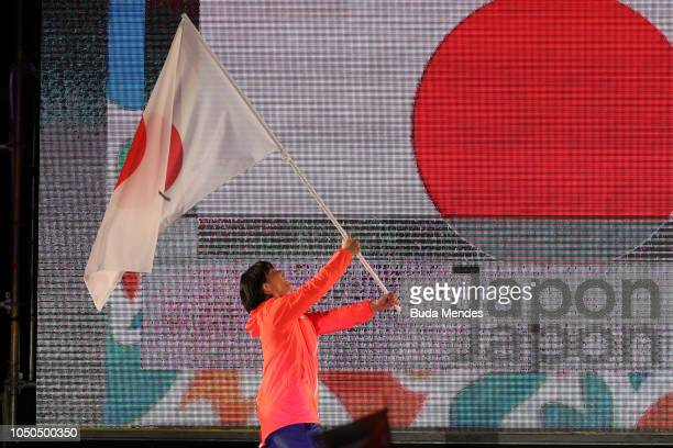 Flagbearer of Japan Yuka Kagami Great Britain cyclist Ross Cullen during the opening ceremony of the Buenos Aires 2018 Youth Olympic Games at...