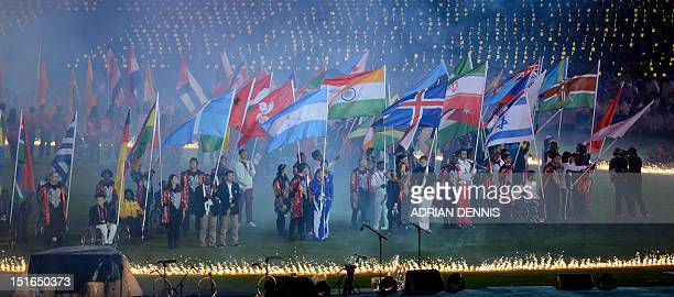 Flagbearers are surrounded by a ring of flame at the closing ceremony of the London 2012 Paralympic Games at the Olympic Stadium in east London on...