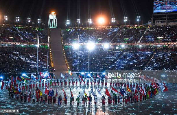 TOPSHOT Flagbearers arrive during the closing ceremony of the Pyeongchang 2018 Winter Olympic Games at the Pyeongchang Stadium on February 25 2018 /...