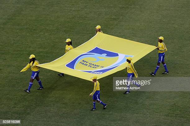 Flagbearers carry the FIFA Fair play flag
