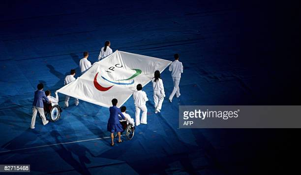Flagbearers carry the International Paralympics Committee flag during the 2008 Beijing Paralympic Games opening ceremony at the National Stadium...
