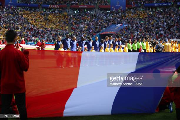 Flagbearers look on as the France players line up for the anthems prior to the 2018 FIFA World Cup Russia group C match between France and Australia...