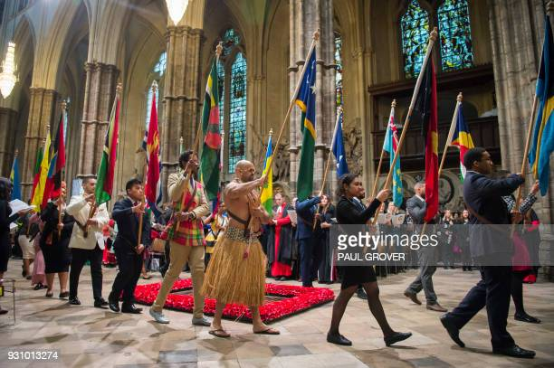 Flagbearers participate in the Commonwealth Day Service at Westminster Abbey in central London, on March 12, 2018. - Britain's Queen Elizabeth II has...