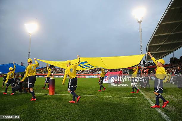 Flagbearers walk out prior to the FIFA U20 World Cup Final match between Brazil and Serbia at North Harbour Stadium on June 20 2015 in Auckland New...