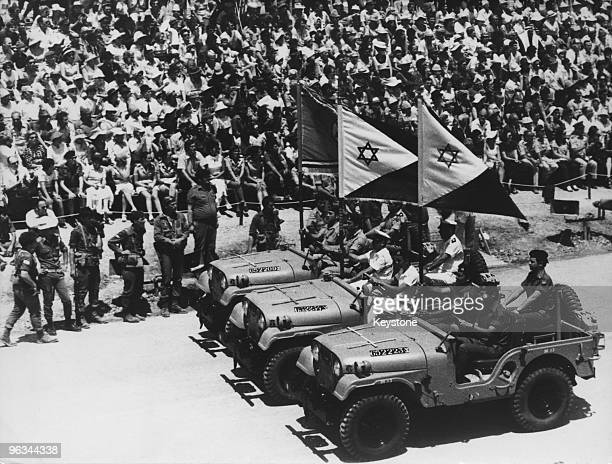 Flagbearing jeeps at the head of a military parade marking the 25th anniversary of the Israeli declaration of independence Jerusalem 8th May 1973