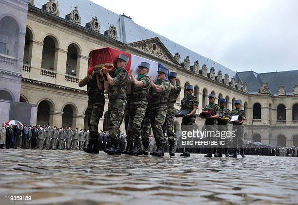 Flagdraped coffins are carried in the Invalides courtyard as France pays tribute to the seven soldiers killed last week in Afghanistan during a...