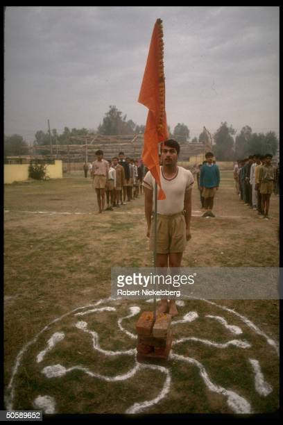 Flagholding youth during early AM physical training shaka of RSS Rashtriya Swayamsevak Sangh Hindu cultural org