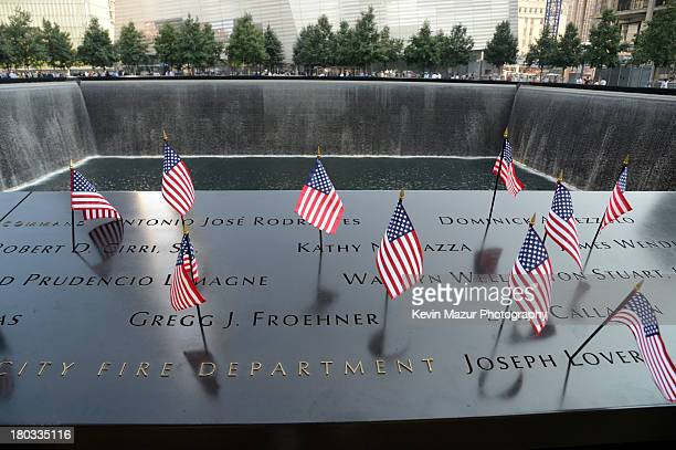 Flags adorn the 9/11 Memorial on the twelfth anniversary of the terrorist attacks on lower Manhattan at the World Trade Center site on September 11...