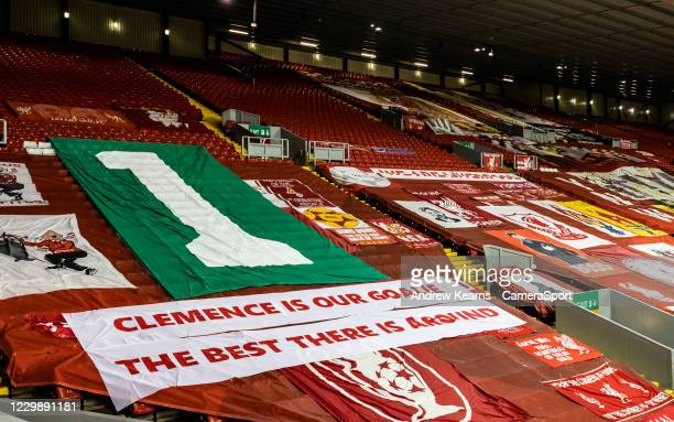 Flags adorning the Kop stand pay tribute to former Liverpool goalkeeper Ray Clemence during the UEFA Champions League Group D stage match between...