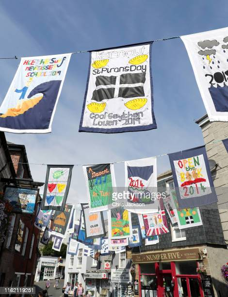 Flags along the main street ahead of the visit by Prince Charles Prince of Wales and Camilla Duchess of Cornwall during day one of their official...