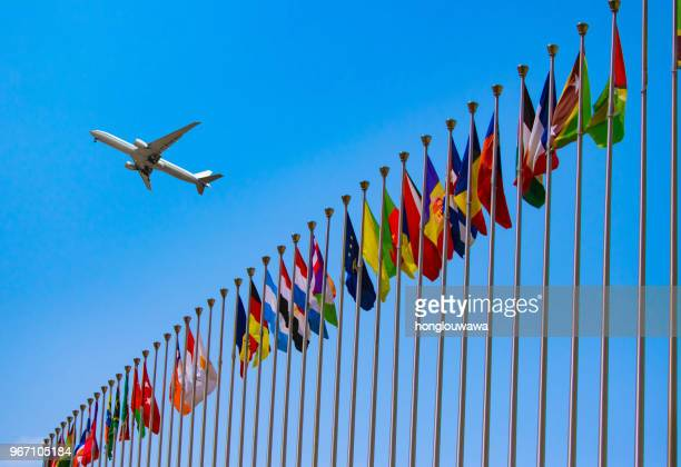 flags and airplane - united nations building stock pictures, royalty-free photos & images