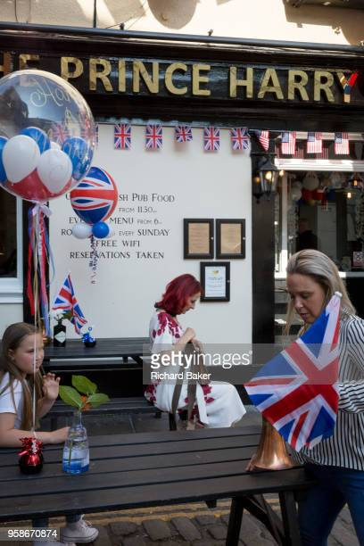 Flags and balloons outside the Prince Harry pub in the old town of Windsor as it gets ready for the royal wedding between Prince Harry and his...