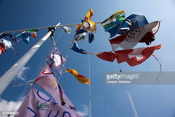 Flags and banners are hoisted in front of St. John of Nepomuk statue, at the Rhine shore of Beuel, across Bonn, Germany, 09 September 2014. John of...