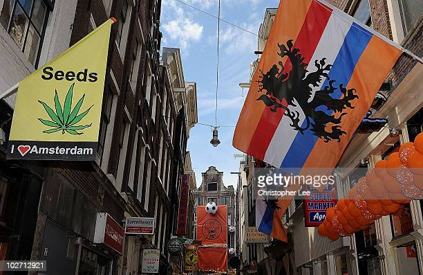 Flags and banners are seen hanging from buildings as Amsterdam prepares for the forthcoming FIFA2010 World Cup Final between Netherlands and Spain on...