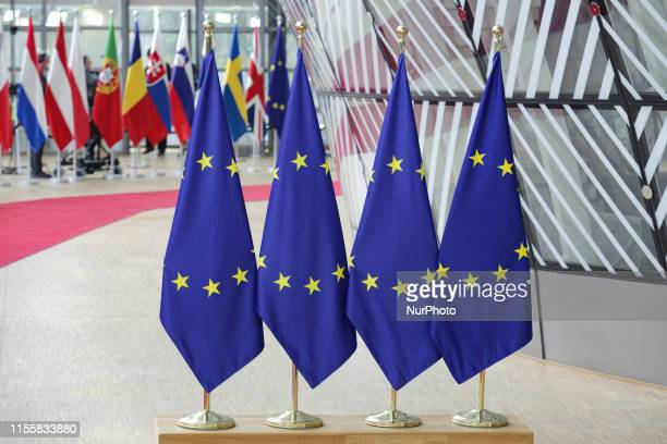 Flags and flags of the European countries state member next to the red carpet where EU leaders arrive in the EU in the European Council building...