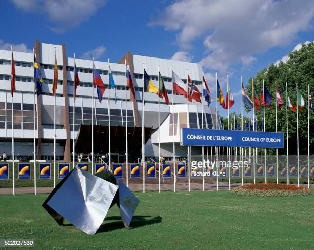 flags and sculpture outside council of europe building - council of europe stock pictures, royalty-free photos & images
