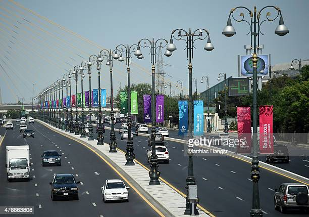 Flags and signage seen at a highway passing the National Gymnastics Arena ahead of the 1st European Games on June 11 2015 in Baku Azerbaijan