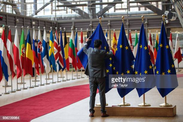 EU flags are arranged at the Council of the European Union on the first day of the European Council leaders' summit on March 22 2018 in Brussels...