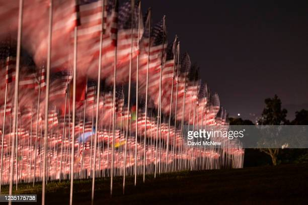 Flags are displayed during the 14th annual Waves of Flags on the eve of the 20th anniversary of the September 11 terror attacks in Alumni Park at...