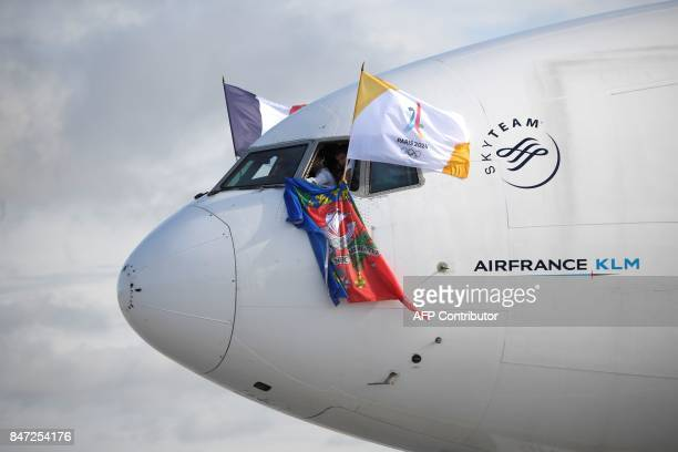 TOPSHOT Flags are displayed from an aircraft cockpit as it taxis on the runway at RoissyCharles de Gaulle Airport on the outskirts of Paris on...