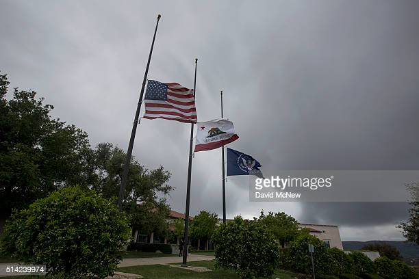 Flags are flown at halfstaff under a stormy sky in honor of former First Lady Nancy Reagan at the Ronald Reagan Presidential Library and Center for...