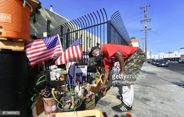 Flags are hoisted at the street corner encampment of homeless veteran Kendrick Bailey on November 10 2017 in Los Angeles California one of the...