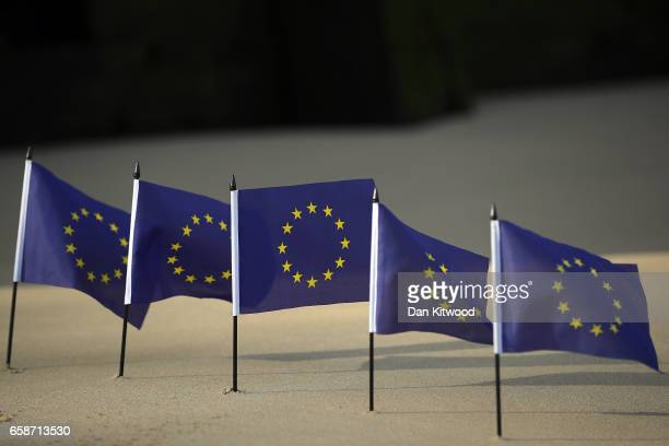 EU flags are lined up on the Thames foreshore on March 28 2017 in London England Article 50 will be triggered on March 29 and the process that will...