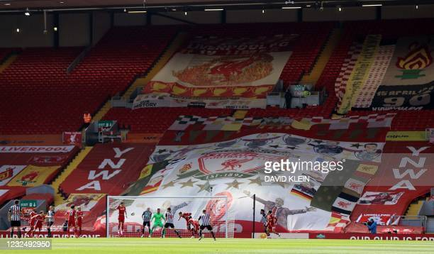 Flags are picture on the empty supporters' seats in the Kop during the English Premier League football match between Liverpool and Newcastle United...