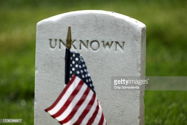 S flags are placed in front of every grave site ahead of the Memorial Day weekend including those of unknown service members in Arlington National...
