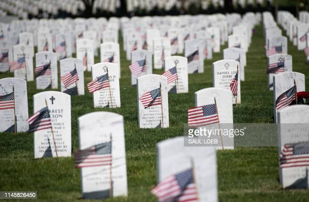 US flags are planted at grave sites at Arlington National Cemetery in Arlington Virginia May 24 ahead of the Memorial Day weekend