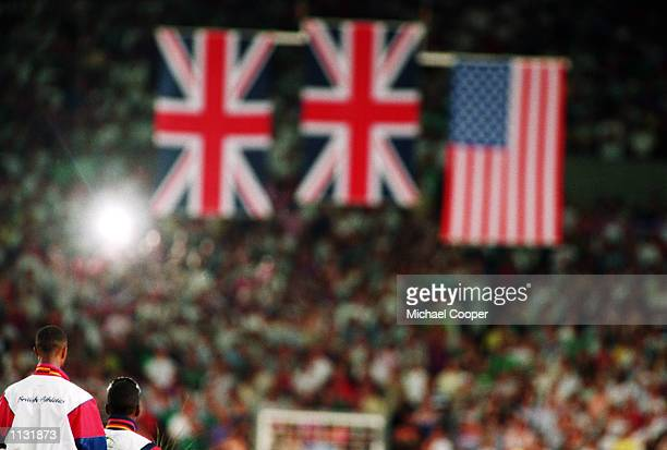 Flags are raised during the medal ceremony after Colin Jackson of Great Britain wins gold in the 110m Hurdles in the world record time of 1291s...