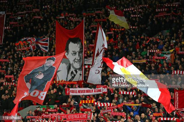 Flags are seen in The Kop during the Premier League match between Liverpool FC and Everton FC at Anfield on December 04 2019 in Liverpool United...