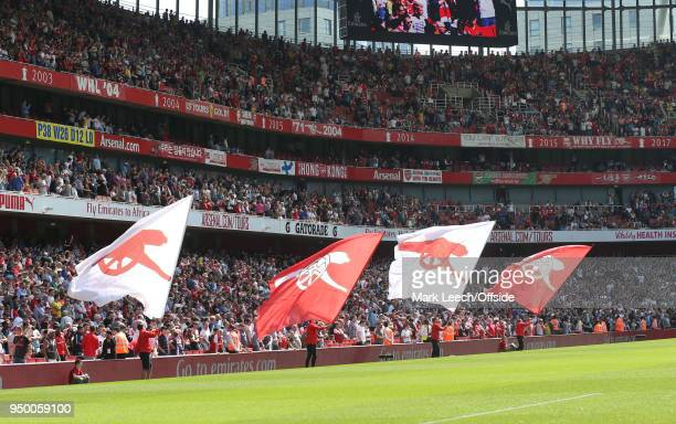 flags are waved before the Premier League match between Arsenal and West Ham United at Emirates Stadium on April 22 2018 in London England