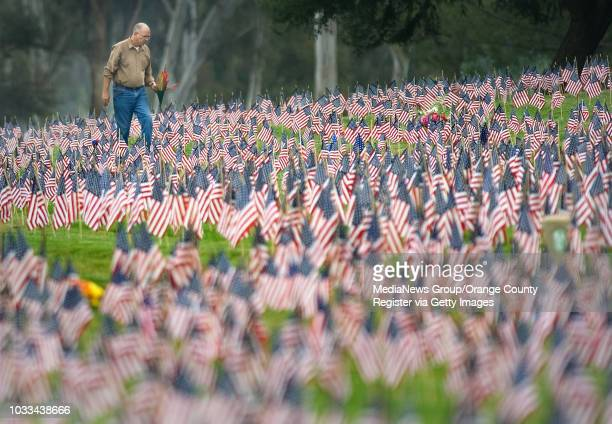 Flags as far as the eye can see decorate Riverside National Cemetery on Saturday, the handiwork of more than 1,000 volunteers. ///ADDITIONAL...
