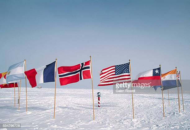 flags at the ceremonial south pole - south pole stock pictures, royalty-free photos & images
