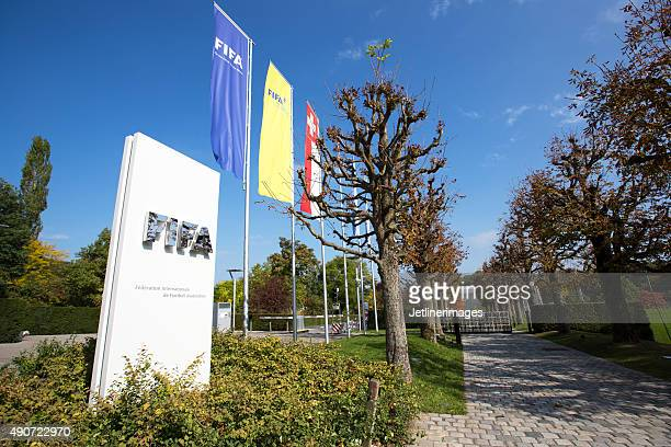 flags at the entrance of the fifa headquarter in zurich - home base sports stock pictures, royalty-free photos & images
