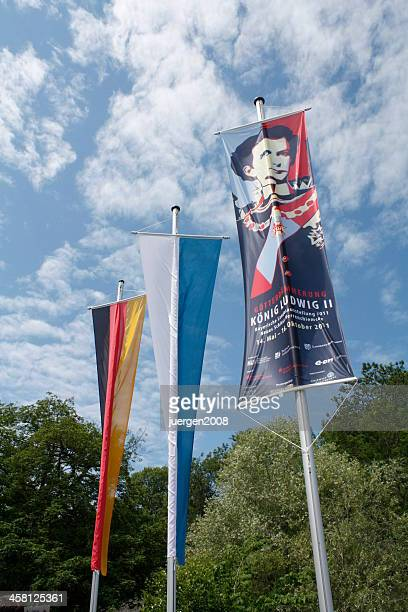 flags at the entrance - flagpole sitting stock photos and pictures