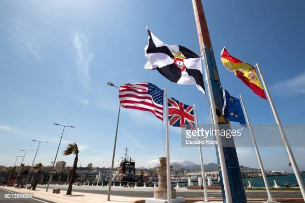 flags at the port of ceuta, spain - ceuta fotografías e imágenes de stock