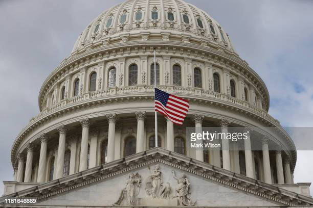 Flags at the US Capitol are lowered to half staff to honor the death of House Oversight and Government Reform Committee Chairman Elijah Cummings on...