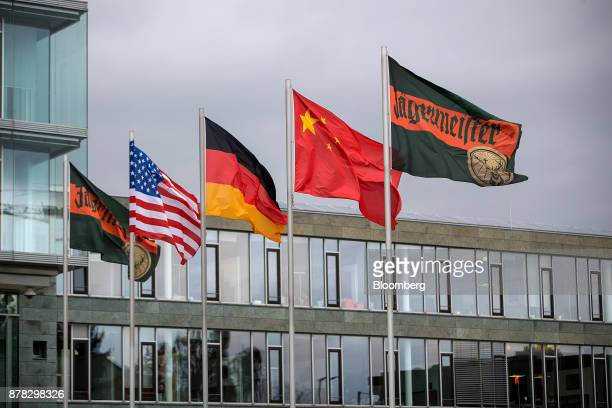 Flags bearing the Jaegermeister logo flank from left US German and Chinese national flags flying outside the company's offices near the...