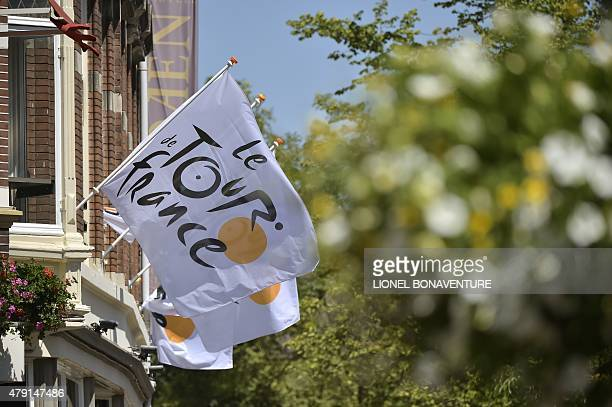 Flags bearing the Tour de France logo are seen on a building on July 1 2015 in Utrecht The Netherlands three days before the start of the 102th...