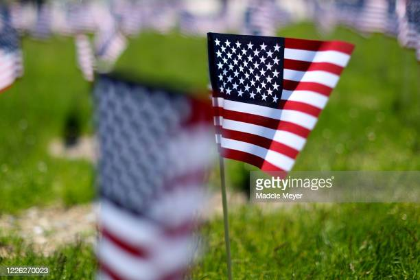 Flags blow in the wind outside of Gillette Stadium on May 21 2020 in Foxborough Massachusetts The Patriots foundation partnered with the...
