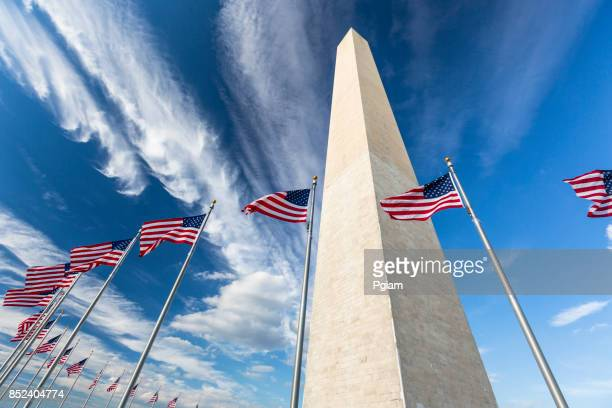 flags by the washington monument - national monument stock pictures, royalty-free photos & images