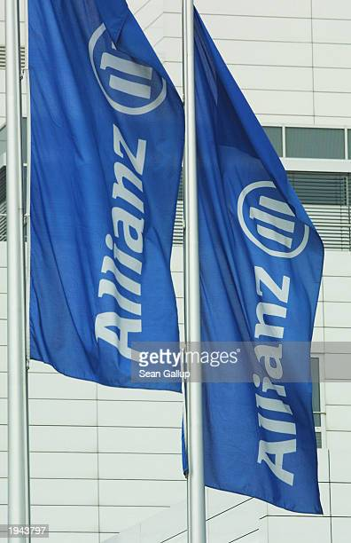 Flags carrying the corporate logo of Allianz AG Germany's largest insurance company on view outside the company offices April 22 2003 in Munich...