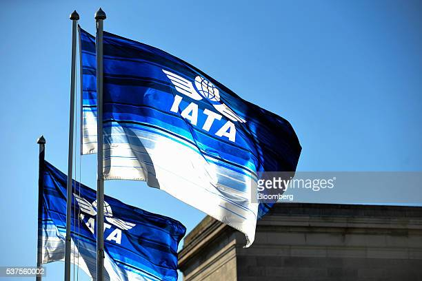 Flags featuring the International Air Transport Association logo fly above the venue of their symposium in Dublin, Ireland, on Wednesday June 2,...